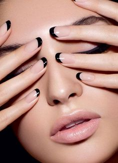 Nails are the perfect way to accent your outfit! Here's some fun & classy nail inspiration for you: nude nails w/ black tips are a fun twist on a classic french manicure.
