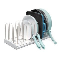 Easily organize and find your favorite cookware with the Youcopia StoreMore Expandable Cookware Rack. The tidy rack extends to fit your cabinet space and features adjustable dividers for arranging heavy items. 4 H, Tabletop, Pull Out Pantry, Taupe, Pan Organization, Organizing Tools, Organising Ideas, Lid Organizer, Divider