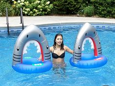 Kids pool party games using Inflatable shark mouths. We used them for races and for throwing shark splash bombs.