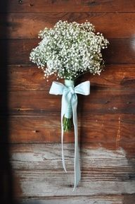 babys breath bouquet. Maybe with a purple satin ribbon. Do u like the bow?