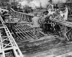 Bridge Work: 1944 - building a bridge in Duren, Germany, 1944. Bombed out houses can be seen in the background.