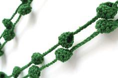 http://nekonekodesign.bigcartel.com/product/ewe-clorofila-bosque-bronce  Ewe de NekoNeko es un collar de bolitas del que te vas a enamorar desde el primer instante.