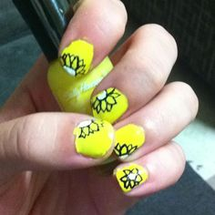 Sun flower nails thought of doing the petals in pink but for now I like the yellow