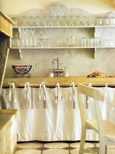 Amazing shaped marble backsplash with open shelving, fabric-faced lower storage and tile floor Cozinha Shabby Chic, Shabby Chic Kitchen, Kitchen Decor, Rustic Kitchen, Open Kitchen, Kitchen Ideas, Paris Kitchen, Kitchen Unit, Mini Kitchen