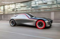 Opel GT Sports Car Concept Stuns - Photo Gallery of auto show news from Car and Driver - Car Images - Car and Driver Opel Gt Concept, Los Cars, Automobile, Auto Retro, Miniature Cars, Rear Wheel Drive, Car And Driver, Future Car, General Motors