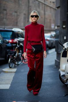 Linda Tol wearing a red knit red velvet pants is seen outside Max Mara during Milan Fashion Week Spring/Summer 2018 on September 21 2017 in Milan...