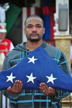 """""""Although still recovering from his injuries overseas, Sgt. Sanchez insisted on leaving his electric wheelchair to walk the flag down Main Street, U., saying """"If it's for the colors, I'll walk."""" NOTE God bless him and all of our Veterans. American Pride, American Flag, Purple Heart Recipients, Independance Day, Army Sergeant, My Champion, Support Our Troops, Real Hero, We Are The World"""