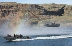 US Army helicopter drops an entire boat full of Navy Seals in the sea