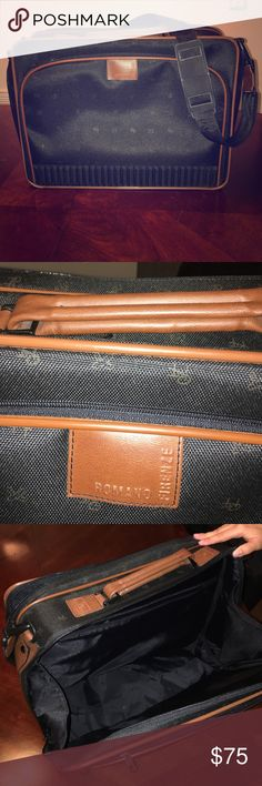 ROMANO FIRENZE SUITCASE Italian suitcase for a stylish man. Purchased in Europe. Can be used for work to carry documents and laptop or for traveling. It has many different large and small compartments. It was never used. In excellent condition. Not one scratch on it. It was always stored in a safe place covered and protected. ROMANO FIRENZE  Bags Briefcases