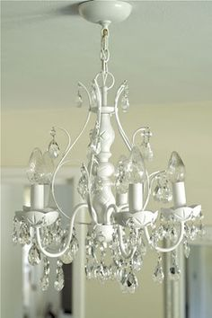 DIY spray paint an old chandelier....one of these is going in my craft room!