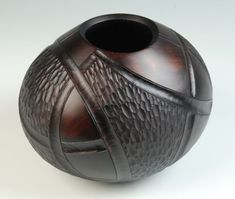 """Roman Stankus - """"Hollow Form"""". Cherry, carved, colored, lacquer."""