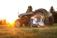 Country style engagement photos in front of a tractor at sunset. Photos taken at Fort Steilacoom Park, out in Lakewood, WA.