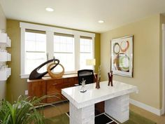 Funky Home Office: Curtainless windows, modern art and crown molding-free ceilings make for a retro home office. Color of walls & carpet!! From HGTVRemodels.com