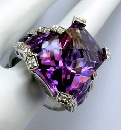 """Bellarri """"Romantica"""" 18K White Gold, Amethyst & Diamond Ring features a total of 15.43 carats of all-natural, earth-mined, untreated and unheated faceted Amethyst set in solid 18K white Gold and complimented by 39 points - more than a third of a carat - of genuine white Diamonds. The center stone is a stunner - the photos you see below were all taken in natural light, with no camera flash - throwing off hues of bubblegum pink, hot pink, violet and purple with hints of periwinkle."""