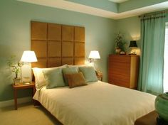 Swing arm, wall-mounted lamps next to bed
