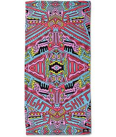 Relax by the pool or beachside with the Argon beach towel from Night Shift. The large beach towel features a soft microfiber front with an all over neon geometric pattern and a white cotton terry back. Get all the Argon pattern products from Night Shift a