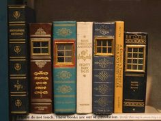 The Stylish House: Fairy Doors of Ann Arbor.Fairy homes and doors made from old books Ann Arbor, Altered Books, Altered Art, Vitrine Miniature, Book Spine, Fairy Doors, Old Books, Antique Books, Book Nooks