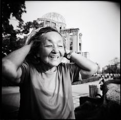 "Hibakusha - Japan's Atomic Bomb Survivors: a Photo Project by Peter Blakely.  Voices of the ""Explosion-Covered People"" Une Toshie, 86. ""When the bomb was dropped over Hiroshima I was 26. I had been working at a nursery for children. I was in the middle of cooking some pumpkin. ... It became pitch dark. I felt something overwhelm me and I was pushed down on the floor. I stayed lying down, stricken with fear. Getting up, I saw an orange-colored scene, extending as far as the eye could see."""