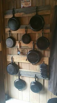 Cast Iron storage idea - maybe smaller for my kitchen Rustic Kitchen Decor, Kitchen Redo, Country Kitchen, Kitchen Design, Kitchen Decorations, Kitchen Ideas, Cabin Kitchens, Cool Kitchens, Kitchen Organization