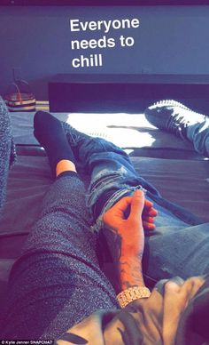 'Everyone needs to chill!' Kylie Jenner posted a Snapchat of her legs entwined with Tyga's on Saturday after 'dumping him on his birthday'