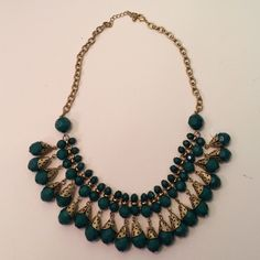Emerald green and gold accent necklace Collar-style emerald bead necklace with gold-colored accents and hardware. Dramatic, pretty look Forever 21 Jewelry Necklaces