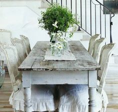 Love the chippy table and French ruffle chairs.
