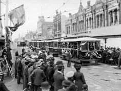 Trams line up in Glenferrie Road, Malvern, near Wattletree Rd, at the launch of the Dandenong Road tram service, Dec 16, 1911. SLV