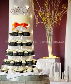 Wedding Cupcake Tower - with regular and small cupcakes, presented with black lace laser-cut wrappers. Top cake covered in buttercream and presented with a silver monogram topper. Venue: Hunter Valley Vineyards, Lindemans Winery.