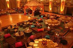 Moroccan furniture with low tables, day beds, rugs, floor pillows, moroccan tent brass trays, lanterns and more