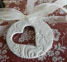 idea for cornstarch dough, could also make shape of Xmas ornament with person's initials as the cut out