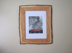 A gorgeous natural edge picture frame made of solid cherry wood. Wonderful cherry red grain with a creamy sap wood border and the trees real Wood Bark, Frames Ideas, Wood Photo, Wood Picture Frames, Art Store, Cherry Red, Rustic Charm, Rustic Wood, Framed Art