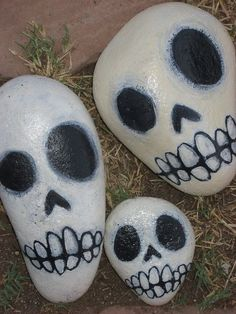 Pebble painting - transform your rocks or stones into skull decorations! Add more color for some Day of the Dead skulls.