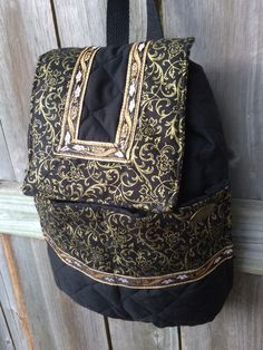 Black and gold Saints bagg