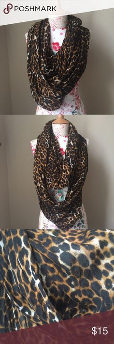 Cheetah print infinite scarf  Great condition! Cheetah print infinite scarf Accessories Scarves & Wraps