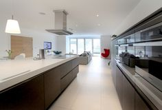 """""""Since this is the hub of our everyday living and numerous parties it is amazing that our SieMatic has not only performed as we knew it would, complete with Miele appliances but that it acts as a comfortable central area to all that we and our visitors do."""""""