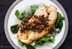 Easy! One pan, cooks in 15 minutes. Like chicken piccata without the breading! Boneless, skinless chicken breasts, pounded thin, seared, served with a caper sauce over arugula, fennel and shaved Parmesan. #glutenfree #LowCarb On SimplyRecipes.com