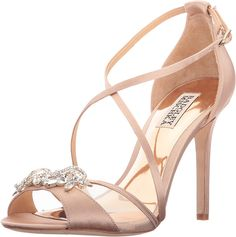 Badgley Mischka Women's Gala Latte Satin Sandal. The Gala delivers femininity via delicate proportions and skinny straps, while her tall stiletto heel is seductively elegant. Upper made of satin fabric. Crisscross vamp straps lead to an ankle strap with buckle closure. Rhinestone embellishment at open toe. Smooth synthetic linings. Wrapped stiletto heel. Leather sole. Imported. Measurements: Heel Height: 4 in Weight: 8 oz Platform Height: 1⁄4 in Product measurements were taken using size…