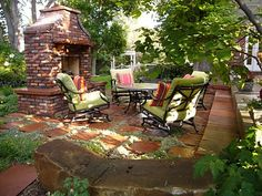 outdoor fireplace: i love the thought of a full-blown fireplace in a cozy, outdoor setting.  with a dash of wine.