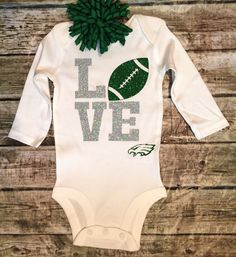 A personal favorite from my Etsy shop https://www.etsy.com/listing/250670116/philadephia-eagles-football-onesie-baby