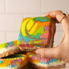 This cheesecake is mesmerizing. #cheesecake #dessert #rainbow #rainbowfoods #dessertbars