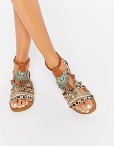 Embellished leopard print sandals the perfect vacation outfit ideas accessory