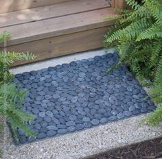We create each piece by hand using river rocks that are washed and polished before affixing to plastic netting. Do not expose your BeachStone to excessive heat. Our Runner comes rolled in a small cardboard sleeve. Placemats are sold open stock. Of course, rocks are inherently weighty so please expect shipping costs to reflect the same. #stone #nature #doormat