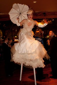 Stilt walkers entertaining the guest at a holiday event with a philanthropic cause creatively woven into the theme.