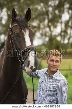 man and his brown horse in nature