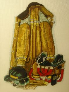 Cross Stitch - proud of my fire fighter husband - modified the pattern somewhat for different helmet to match his