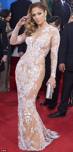 Dangerous curves: J.Lo displayed her sizzling curves in the flesh-coloured Zuhair Murad figure-hugging gown featuring an ivory embroidered lace overlay with beading detail which strategically covered her modesty