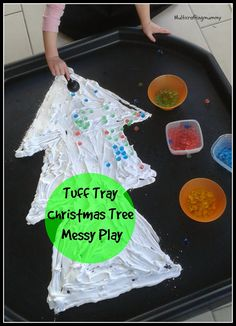 T is for tree. Christmas Tree Messy Play in a tuff tray using shaving foam and waterbeads. Great activity for toddlers and pre-schoolers.