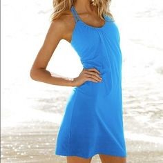 """Victoria's Secret Braided Strap Bra Top Dress One hot little halter dress for fun in the sun—and well after sundown. With the lightest layer of support built right in and braided double straps, this bra top dress gets noticed at the beach, on the boardwalk and beyond. Simply sexy in an always-chic A-line silhouette. Built-in shelf bra. Double halter strap ties at neck. A-line. 17"""" from waist. Imported cotton. The color of the dress is not as bright as on first two pictures. Victoria's Secret…"""