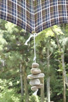 Tablecloth, umbrella weights of rocks.