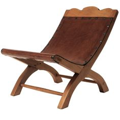 """Child's Butaque from the  Residence of Mexican actor, writer and film director """"El Indio"""" Fernandez.  This wood and leather chair is atributed to Clara Porset."""